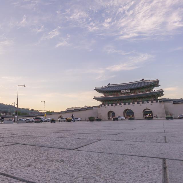 """Gwanghwamun Gate, Gyeongbokgung Palace in Seoul, South Korea during sunset."" stock image"