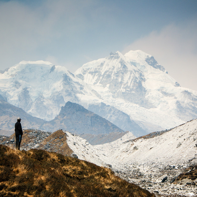 """A man contemplates the size of Kanchenjunga"" stock image"
