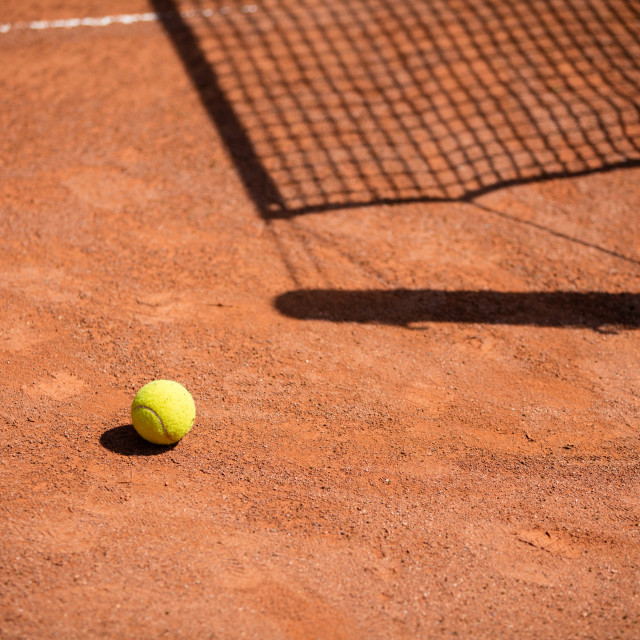 """""""Tennis balls on the ground of clay court"""" stock image"""