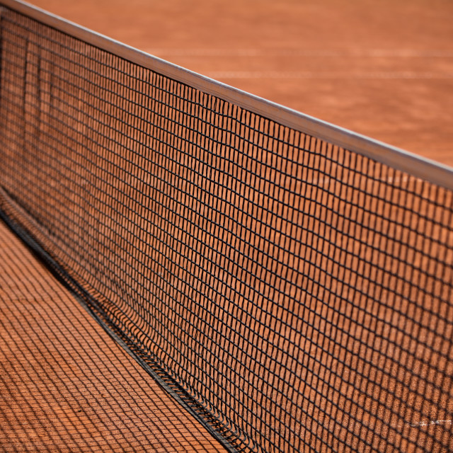 """Tennis balls on the ground of clay court"" stock image"