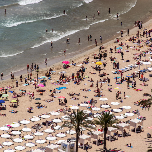 """Crowded Beach"" stock image"