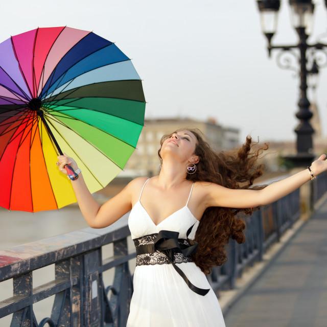 """woman walking with umbrella"" stock image"