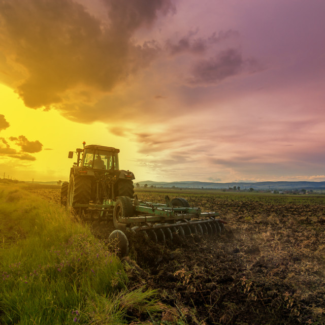 """Tractor plowing"" stock image"