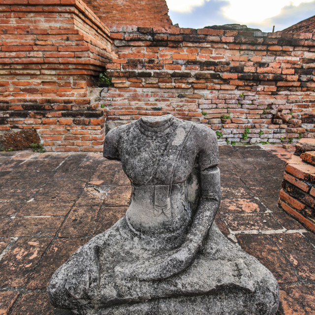 """Buddha Statue Loses Head"" stock image"