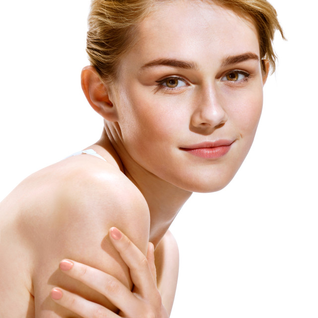 """Image with beautiful blonde girl on white background. Close-up of an attractive girl of European appearance. Skin care concept"" stock image"