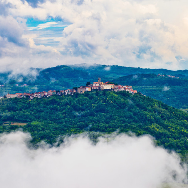 """Motovun town in clouds view"" stock image"