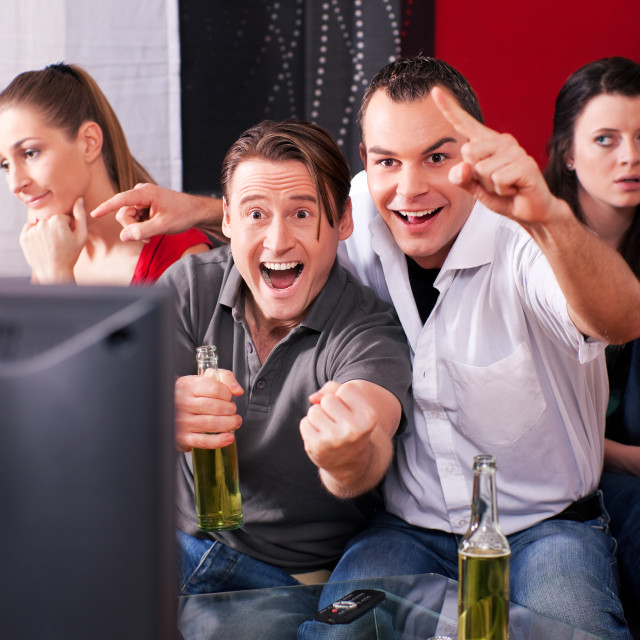 """Friends watching TV"" stock image"