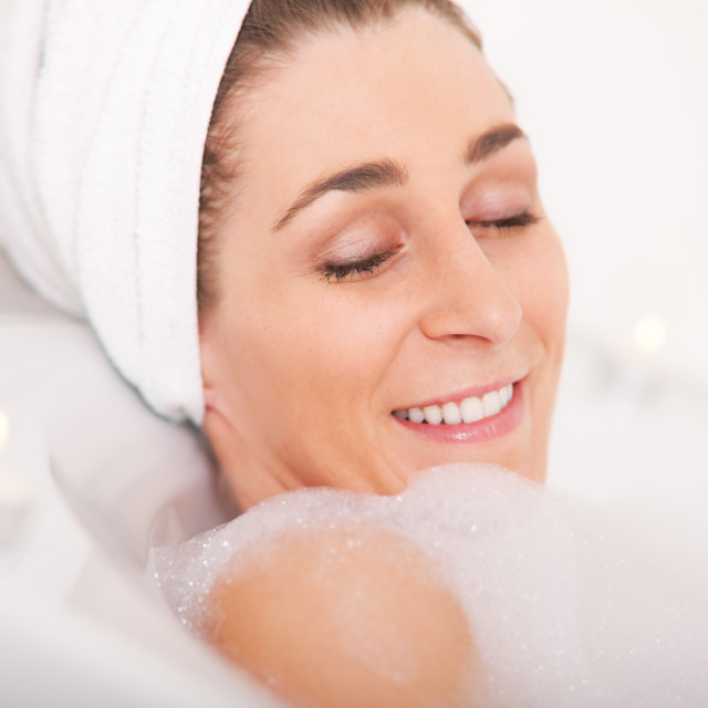 """Woman takes bath"" stock image"