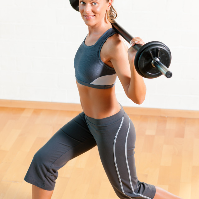 """""""Woman with barbell in gym"""" stock image"""