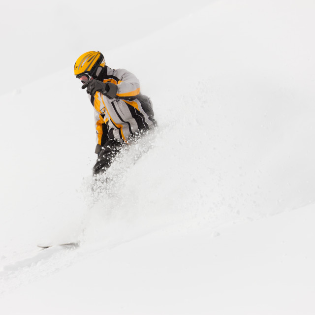 """""""Snowboarder skiing downhill"""" stock image"""