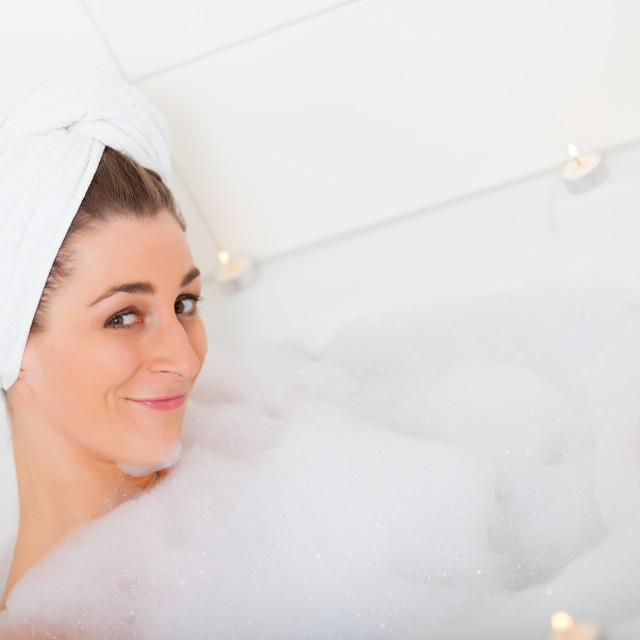 """Woman takes bubble foam bath"" stock image"