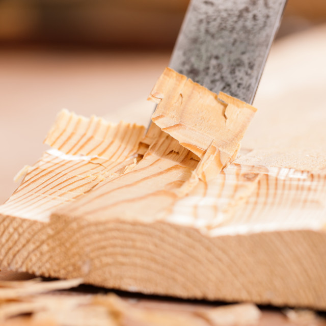 """Carpenter with chisel and hammer"" stock image"