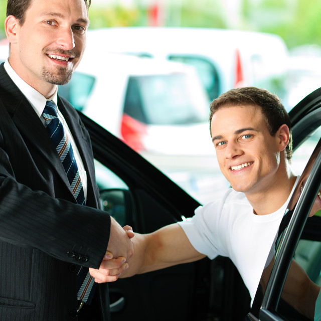 """""""Man buying car from salesperson"""" stock image"""