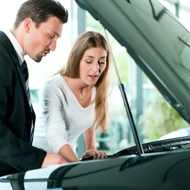 """""""Woman buying car from salesperson"""" stock image"""