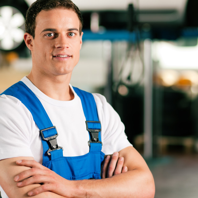 """Car mechanic in workshop"" stock image"