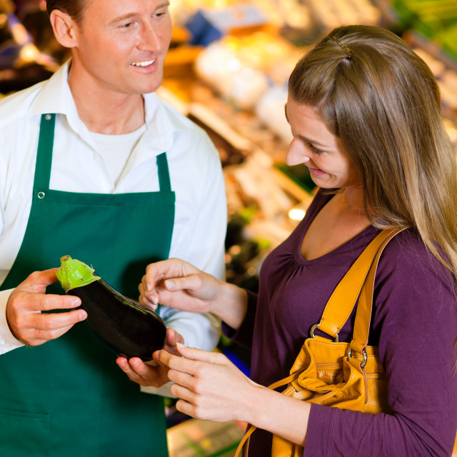 """""""Woman in supermarket and shop assistant"""" stock image"""