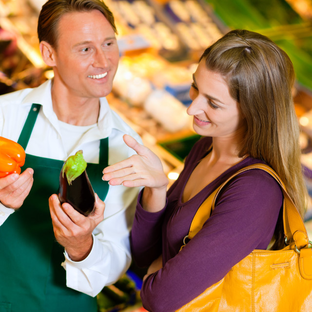 """Woman in supermarket and shop assistant"" stock image"