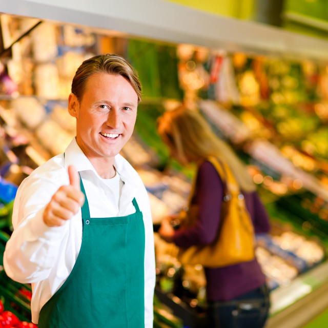 """Man in supermarket as shop assistant"" stock image"