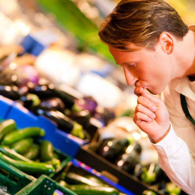 """""""Man in supermarket as shop assistant"""" stock image"""
