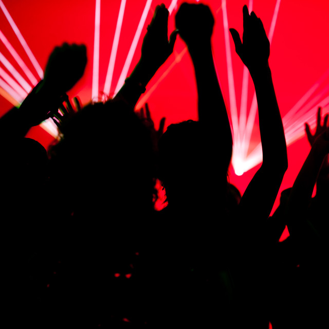 """People dancing in club with laser"" stock image"