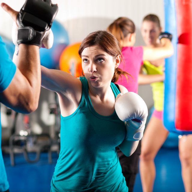 """""""Female kick boxer with trainer in sparring"""" stock image"""