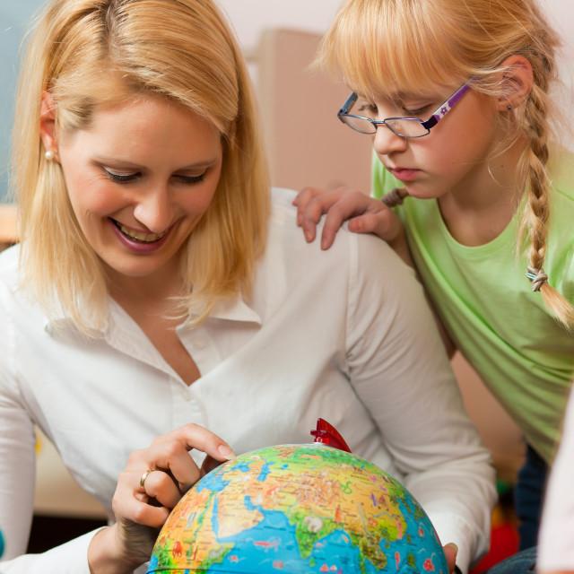 """Mother explaining the world to her children"" stock image"