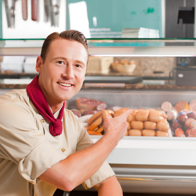 """""""Working in a butchers shop"""" stock image"""