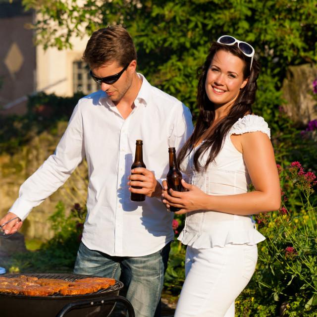 """Couple doing BBQ in garden in summer"" stock image"