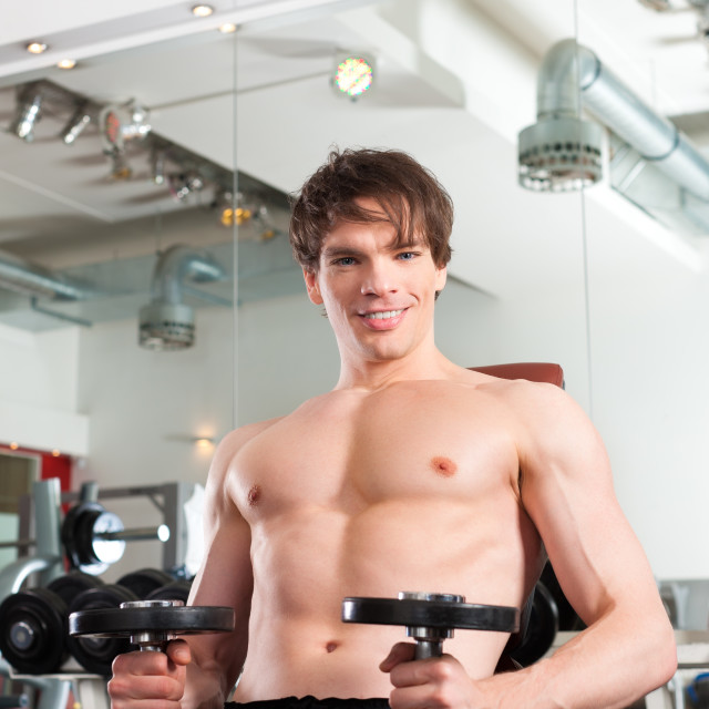 """Sport - man is exercising with barbell in gym"" stock image"