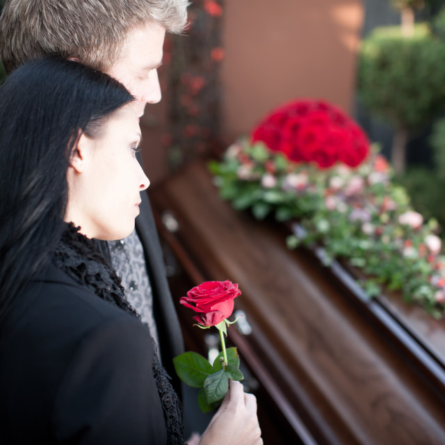 """People at Funeral with coffin"" stock image"