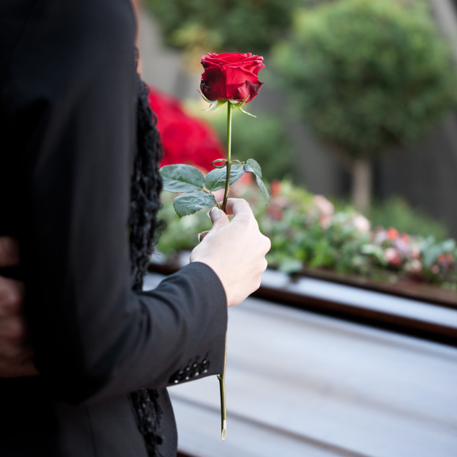 """Woman at Funeral with coffin"" stock image"