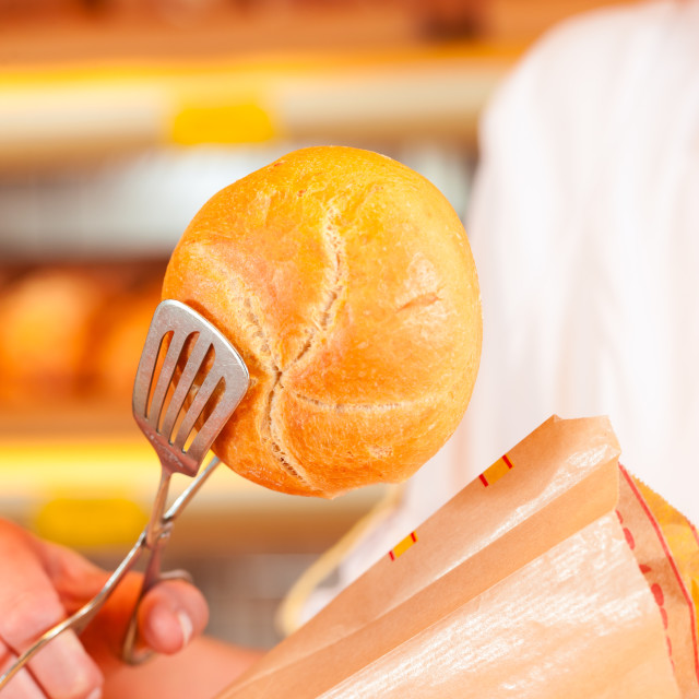 """""""Salesperson is packing bread in bakery"""" stock image"""