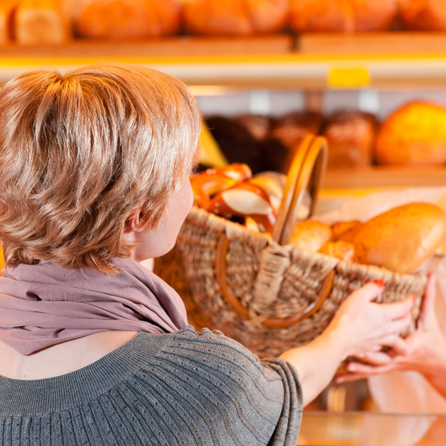 """""""Salesperson with female customer in bakery"""" stock image"""