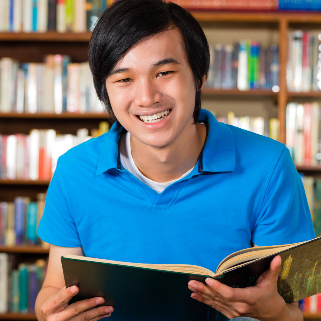 """""""Student in library reading book"""" stock image"""