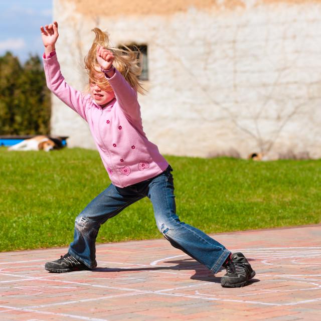 """""""Girl playing in spring garden having fun"""" stock image"""