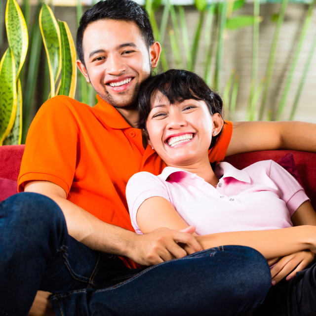 """Asian couple at home"" stock image"