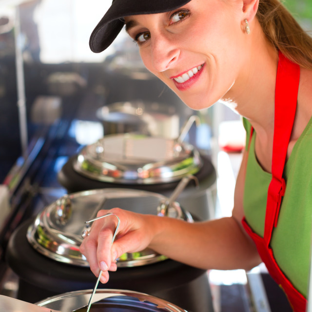 """""""Young emloyee of an concession stand"""" stock image"""