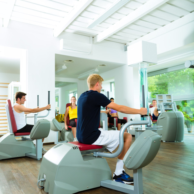 """""""People in sport gym on machines"""" stock image"""