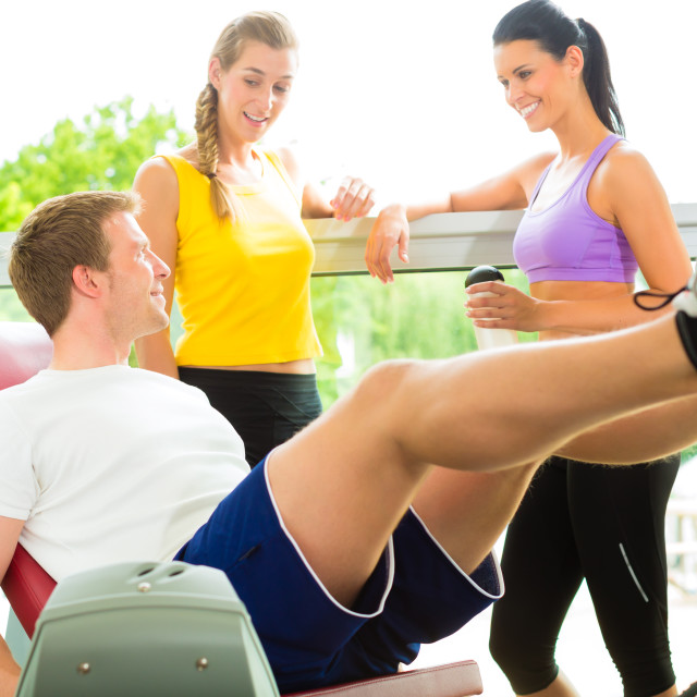 """""""People in sport gym on the fitness machine"""" stock image"""