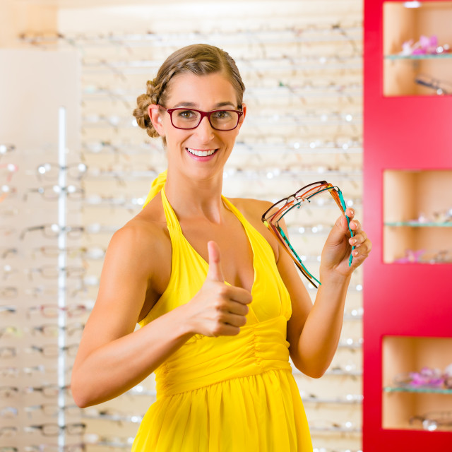 """""""Young woman at optician with glasses"""" stock image"""