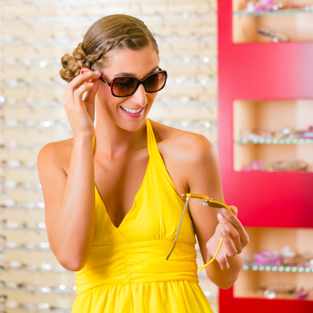 """""""Young woman at optician with sunglasses"""" stock image"""