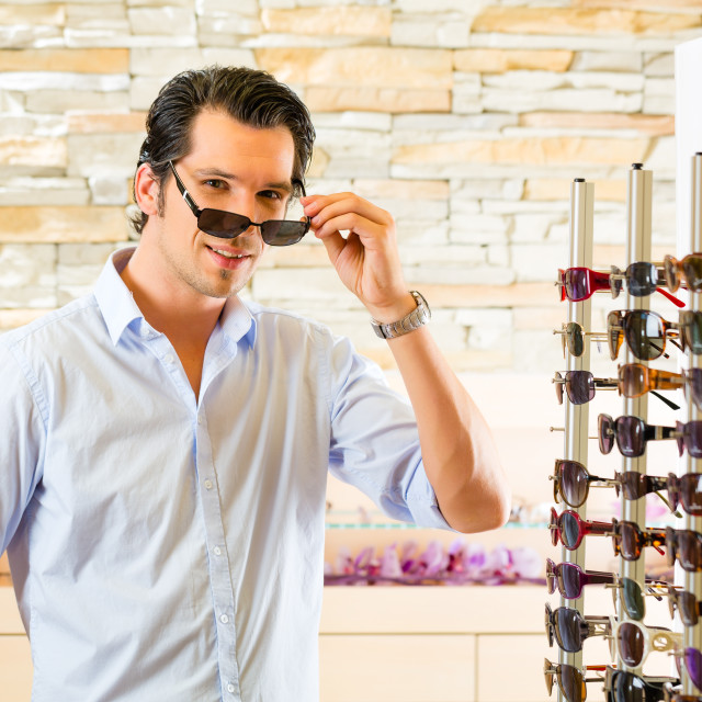 """""""Young man at optician buying sun glasses"""" stock image"""
