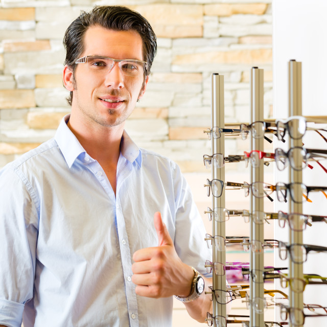 """""""Young man at optician with glasses"""" stock image"""