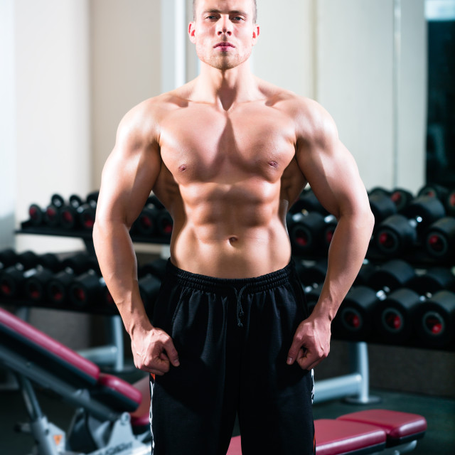 """Bodybuilder posing in Gym"" stock image"