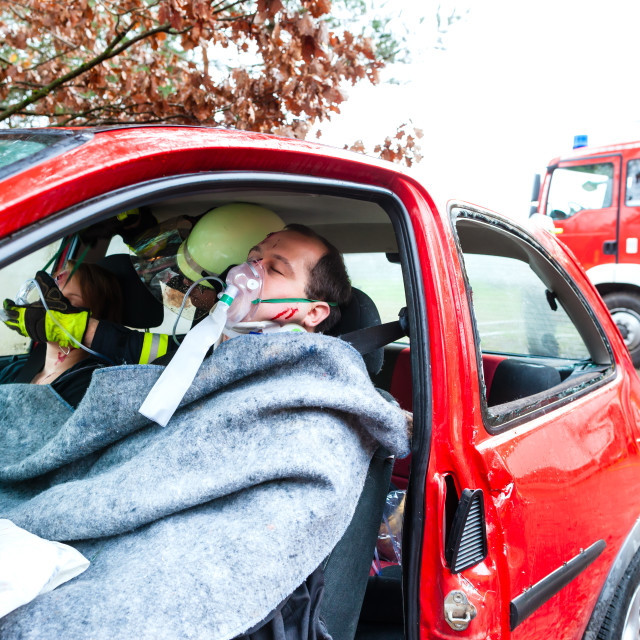 """""""Accident - Fire brigade rescues Victim of a car"""" stock image"""