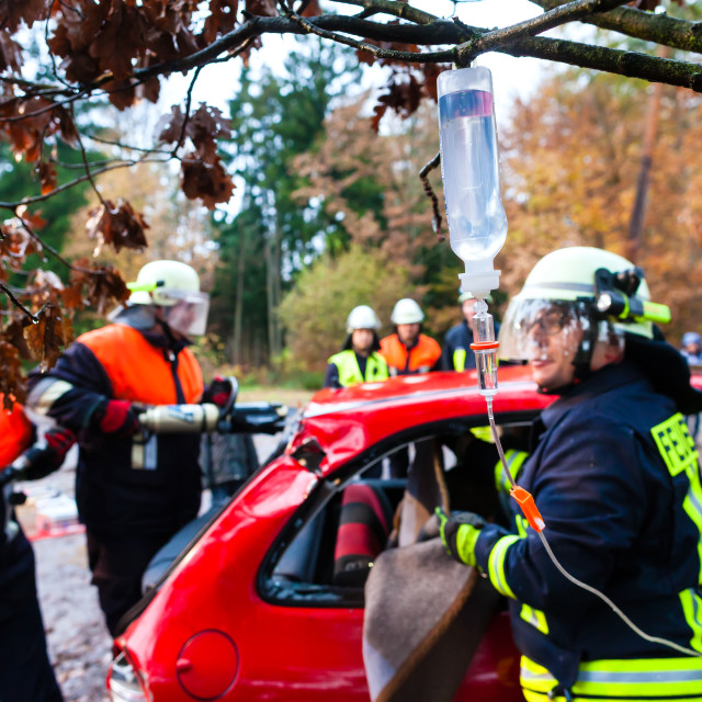 """Accident - Fire brigade rescues Victim of a car crash"" stock image"