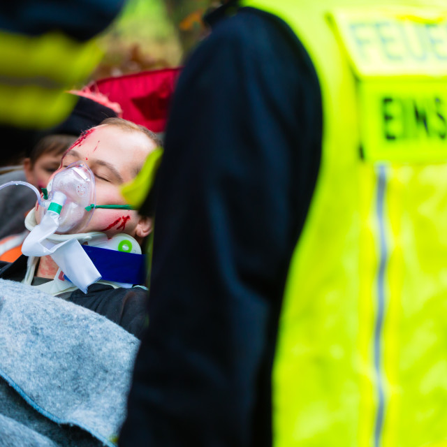 """""""Accident - Fire brigade, Victim with respirator"""" stock image"""