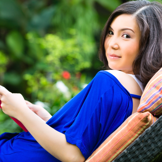 """Young Asian woman at home in garden"" stock image"