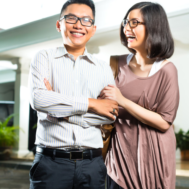 """""""Asian homeowner couple in front of home"""" stock image"""