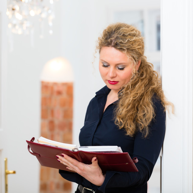 """""""After Hour - woman at home with address book"""" stock image"""